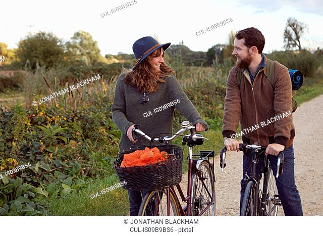 Couple enjoying cycling on marshes