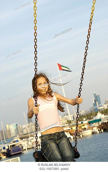 Happy Girl on a swing in Dubai, United Arab Emirates