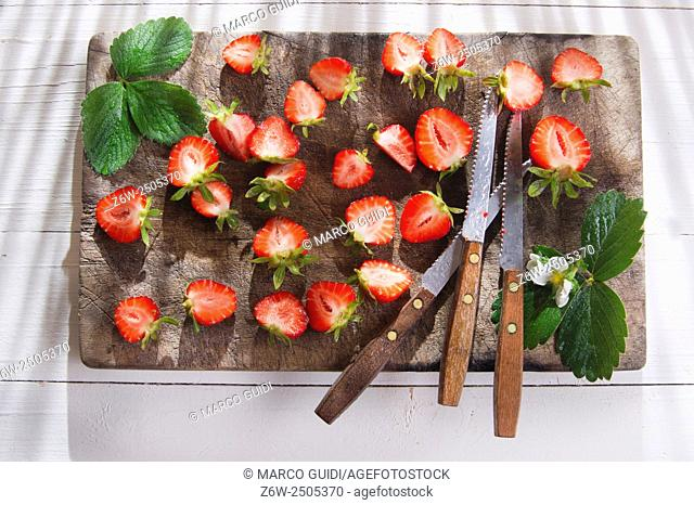 Small pieces of strawberries for the preparation of salad