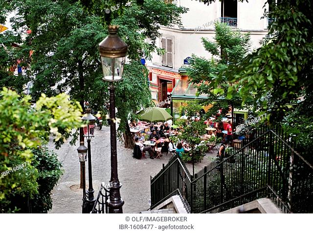 Terrace of a restaurant at the foot of the Rue Maurice Utrillo, Montmartre district, Paris, Ile de France region, France, Europe