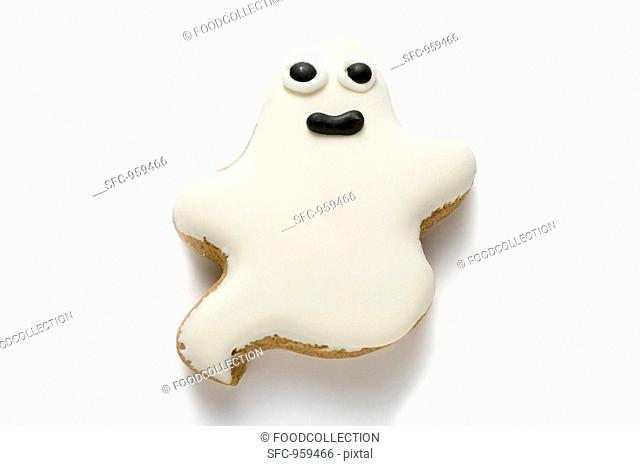 A ghost biscuit with white icing for Halloween