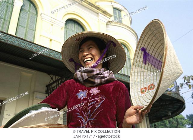 Female / Woman Street Vendor Selling Conicle Hats, Hanoi, Vietnam