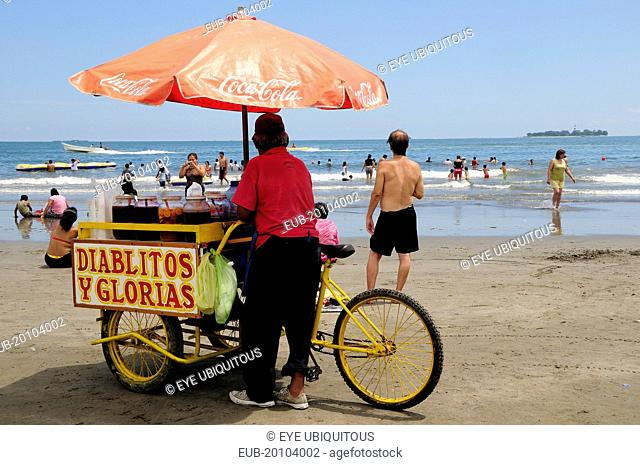 Snack seller on Playa Villa del Mar with people on beach and in sea