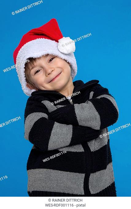 Portrait of boy with santa hat, smiling