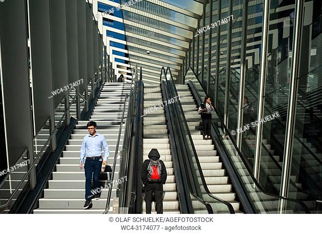 Sydney, New South Wales, Australia - People are seen standing on an escalator that leads to the sheltered Barangaroo Pedestrian Bridge in the business district...