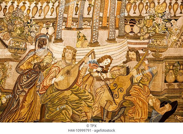 England, Oxfordshire, Oxford, Ashmolean Museum, Spanish Tapestry depicting A Musical Party dated 1650