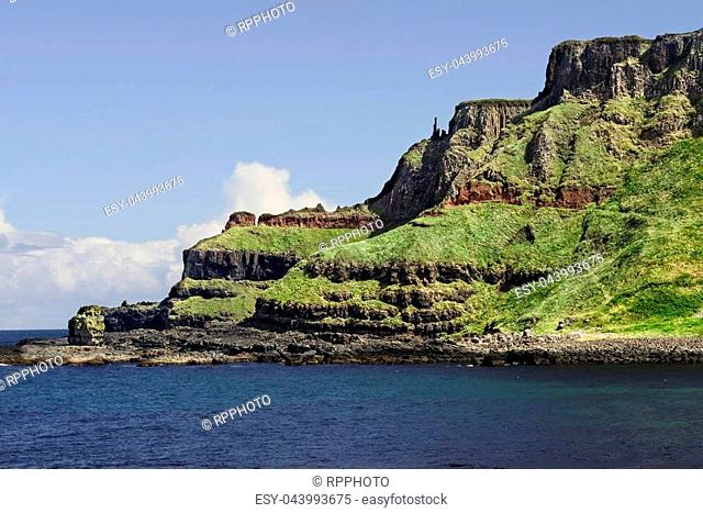 """A notable feature of the Giant's Causeway is the natural stacking of stones on the edge of the Antrim Plateau. It has been named the """"""""Chimney Stacks"""""""""""