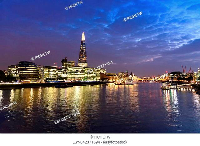 Panoramic view of london city skyline and River Thames from Tower Bridge, UK, in the dusk evening, selective focus