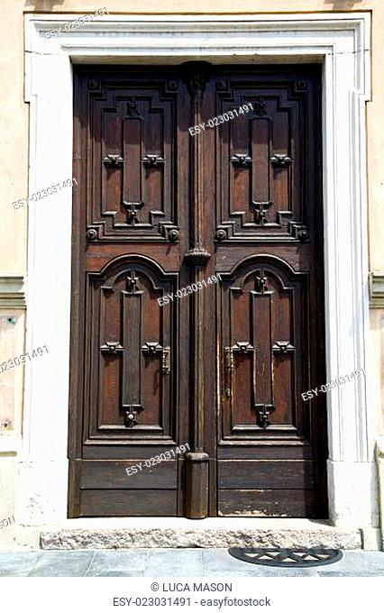europe italy lombardy   in the milano  church door closed brick  pavement