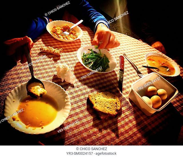 People eat in a home in Prado del Rey, Sierra de Cadiz, Andalusia, Spain
