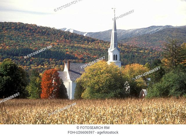 church, fall, Waitsfield, VT, Vermont, Scenic view of the United Church of Christ surrounded by colorful fall foliage from a cornfield with the first snow on...
