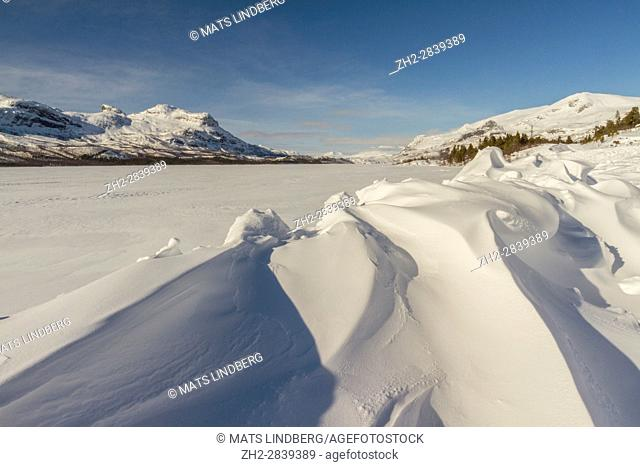 Landscape in winter in Stora sjöfallets national park, snow over the lake, mountains in background, Stora sjöfallets national park, Laponia, Gällivare