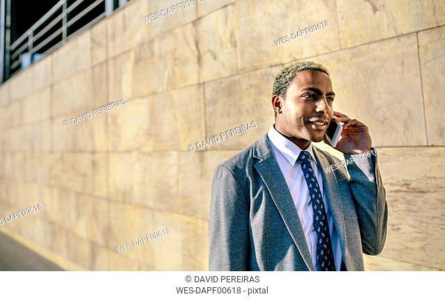 Businesman talking on his smart phone