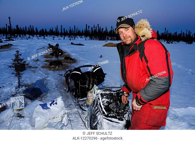 Nathan Schroeder at the Cripple checkpoint during the Iditarod Sled Dog Race 2014