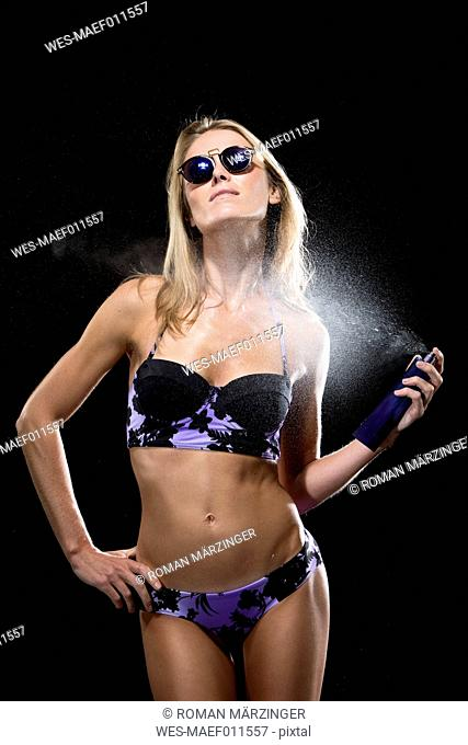 Woman with parfum, bikini