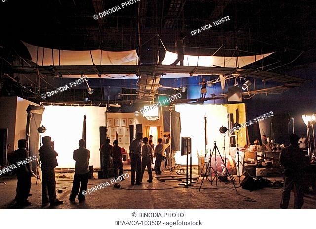South Asian Indian Bollywood film star Amitabh Bachchan shooting for ad film in Mehboob studio ; Bombay Mumbai ; Maharashtra ; India
