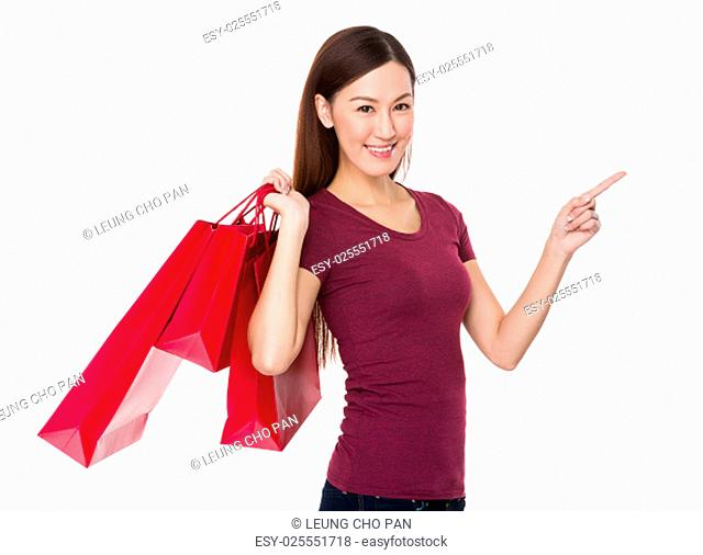 Woman hand hold with shopping bag and finger point up