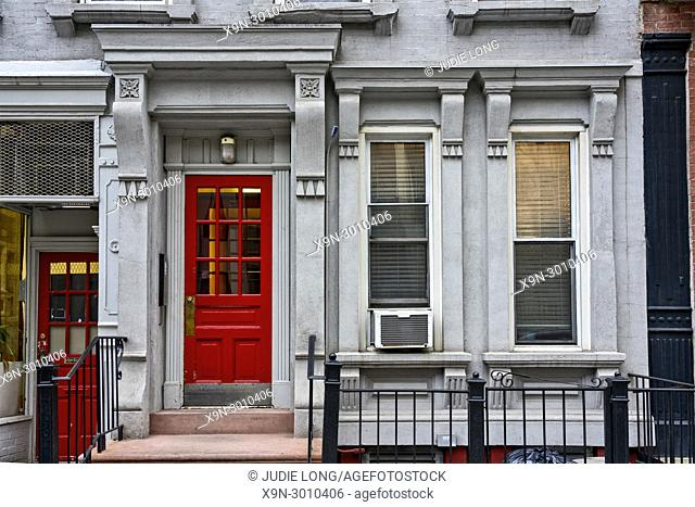 Entrnce to an Upper East Side, Manhattan, NYC, Tenement Apoartment Building. Engrance to a Retail Store on the Left