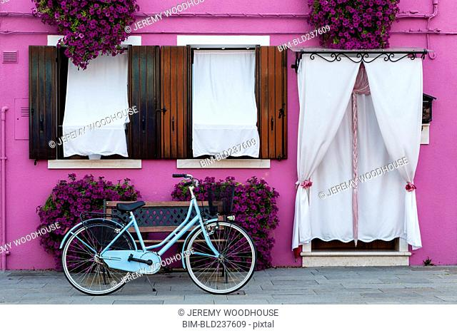 Bicycle at purple house, Burano, Veneto, Italy