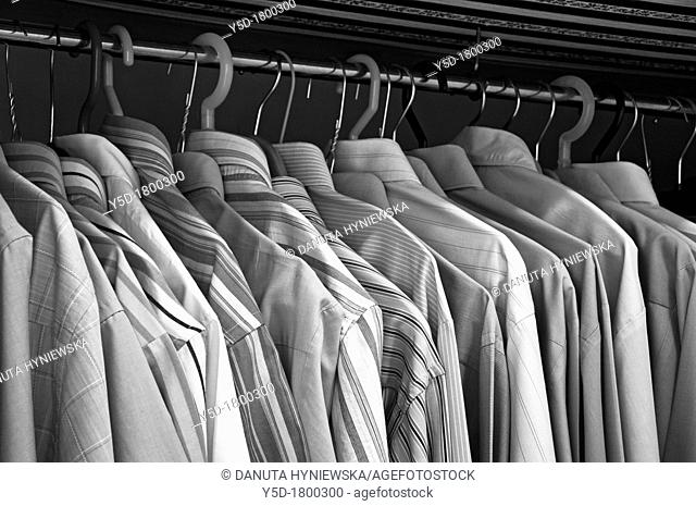 private men's wardrobe full of men's shirts