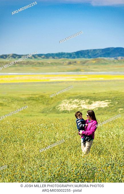 Mother holding son in meadow atCarrizoPlain National Monument, California, USA