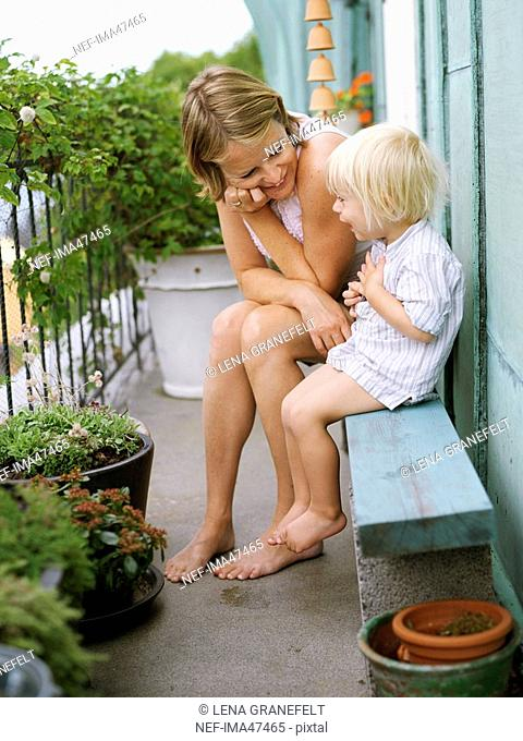 Mother and son on a balcony Sweden