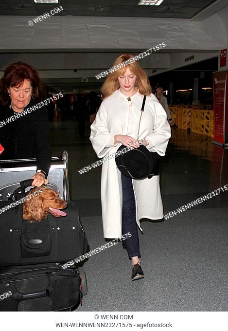 Christina Hendricks arrives at Los Angeles International Airport (LAX) for a departing flight with her dog in a carrier Featuring: Christina Hendricks Where:...