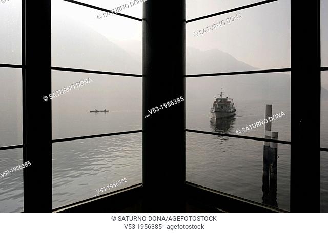 boat arriving at pier, Lake Como, Italy