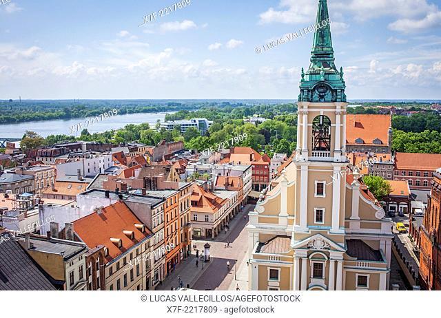 Church of the Holy Spirit and Rozana street, in background Vistula river, Torun, Poland