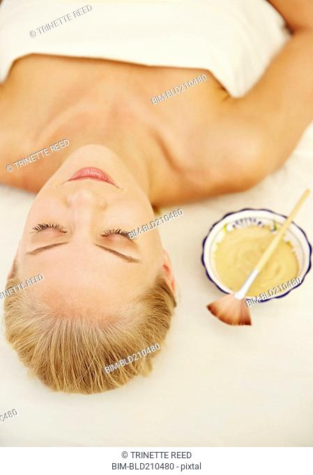 Caucasian woman laying on massage table