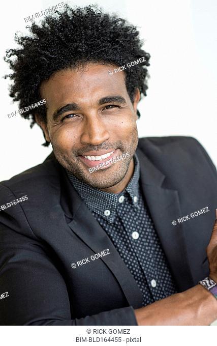 Close up of smiling Hispanic businessman