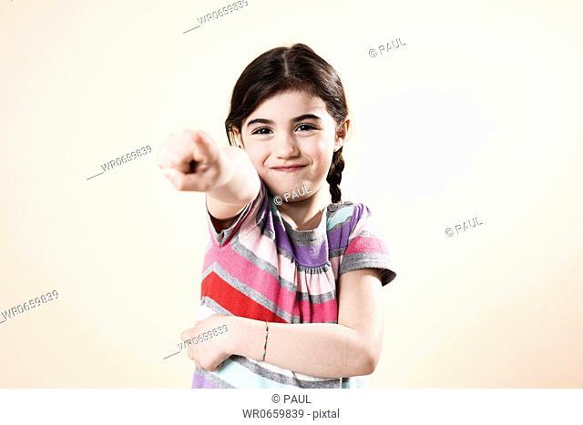 Grinning girl pointing her finger