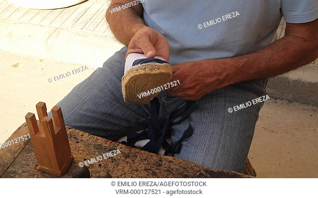 Making and alpargata. Typical Spanish shoe. Ancient artisans fair. Fondarella, Lleida, Catalonia, Spain