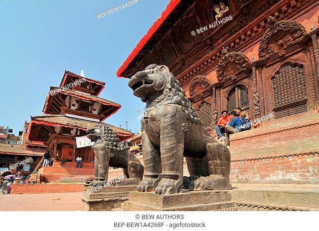 Nepal, Kathmandu, Lions stone statue of Shiva Parvati Temple at Durbar Square
