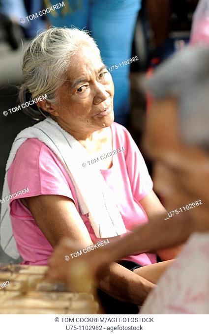 elderly woman with busker cebu city philippines