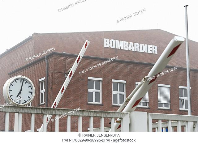 A barrier goes down at the facilities of Bombardier Transportation in Hennigsdorf, Germany, 29 June 2017. The company's supervisory board aims to decide...