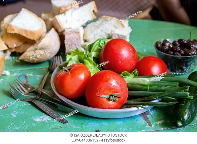 Traditional Turkish Village breakfast table with bread,tomatoes,olive and cucumber