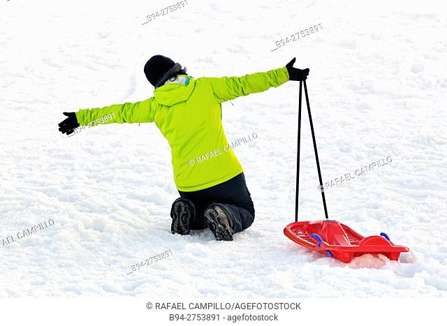 Woman with a sled. La Molina, ski resort in the Pyrenees mountains of northeastern Spain, in the municipality of Alp in the comarca of Cerdanya in Girona