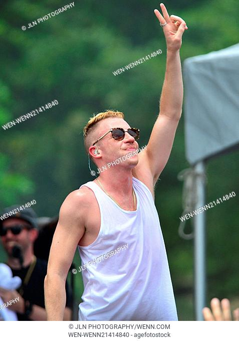 Macklemore and Ryan Lewis performing live on stage at Aventura Mall Parking Lot Featuring: Macklemore Where: Aventura, Florida