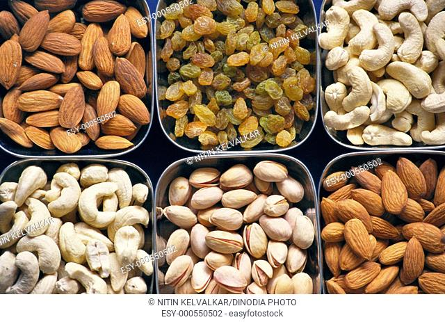 Dry fruits cashew , nuts , almonds , pista pistachio , dried grapes, Diwali Deepawali festival , Bombay Mumbai , Maharashtra , India