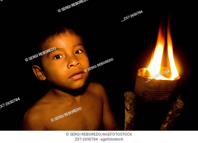 Yagua tribe located near Iquitos, Amazonian, Peru. Inside of a straw hut to attend a sort of ceremonial dance called bujurqui where fire dance in a circle