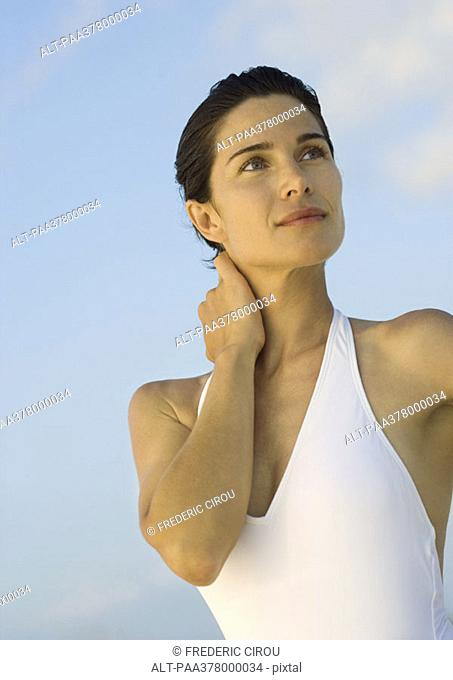 Woman in swimsuit, looking away