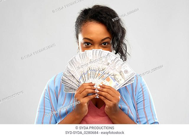 excited african american woman with dollar money
