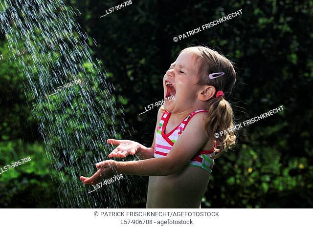 girl having shower outdoors, Switzerland