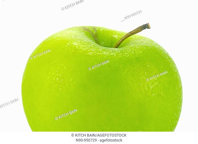 A rgreen apple isolated against a white background