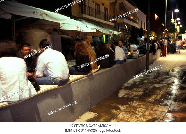 People drinking at a bar in Gazi. The entire Gazi neighborhood has been restored and renovated by the city authorities. It is now a popular location for...