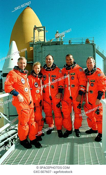01/06/2001 -- The STS-98 crew poses for a group photo on the 215-foot level of the Fixed Service Structure at Launch Pad 39A