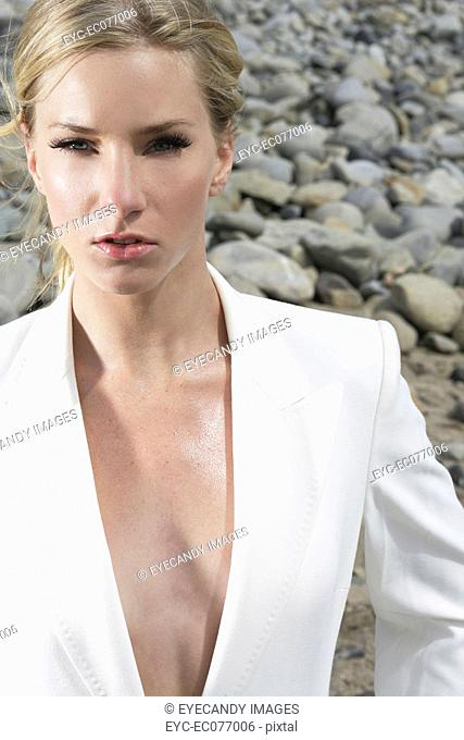 Portrait of young sexy businesswoman at the beach