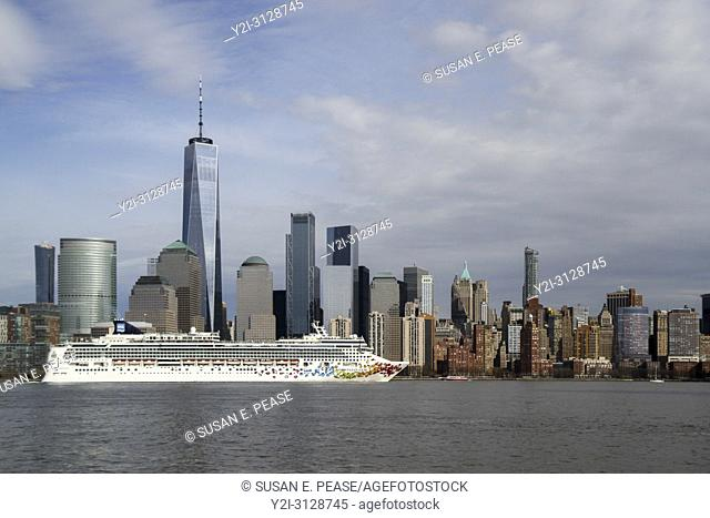 The Norwegian Gem cruise ship passing by One World Trade Center and other Lower Manhattan skyscrapers, New York, New York, United States