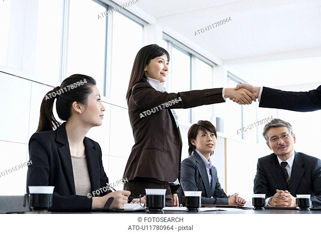 Business Scene, Five People at Meeting, Shaking Hands